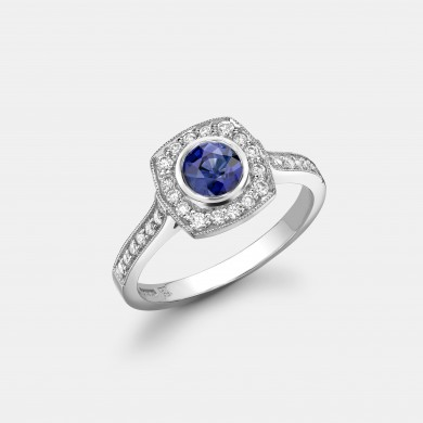 The Platinum, Blue Sapphire and Diamond Halo Ring