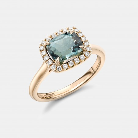 Robert Bicknell's beautiful blue tourmaline ring, surrounded by a halo of 22 colourless diamonds and set in 18k yellow gold.